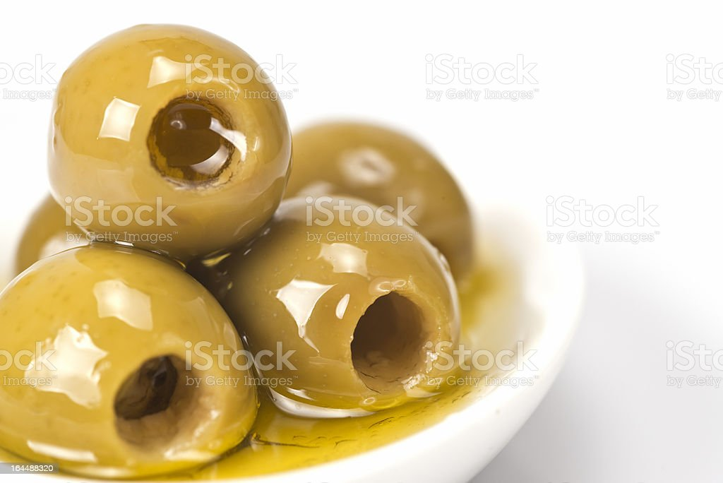 Pitted olives on a white background royalty-free stock photo