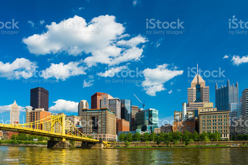 Pittsburgh downtown skyline, bridge, river, and puffy cumulus clouds stock photo