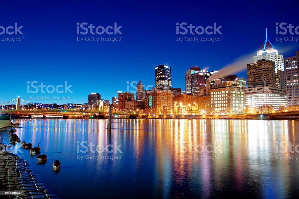 Pittsburgh skyline reflecting in Allegheny River stock photo