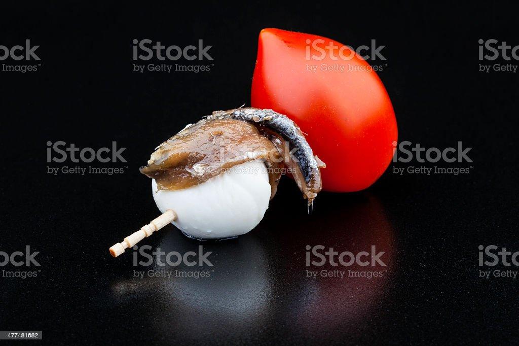 Pitxo de anchoa con tomate y  mozzarella stock photo