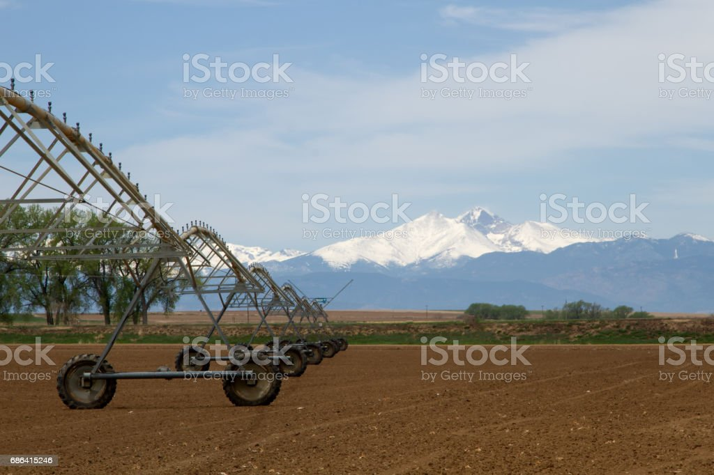 Pivot Irrigation System in an agriculture field with Longs Peak in the background stock photo