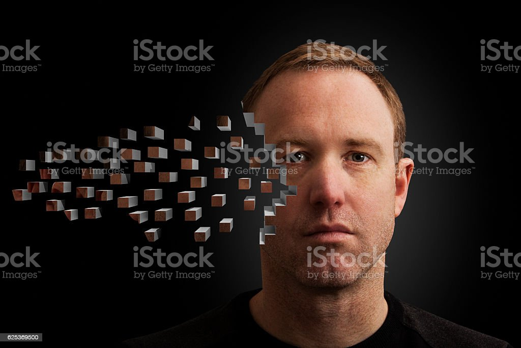 A horizontal studio shot of male, who\'s face is built up by pixel...