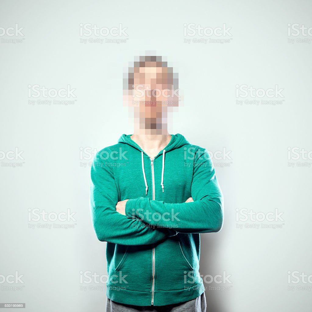 A portrait of a person from the waist up, whose face has been...
