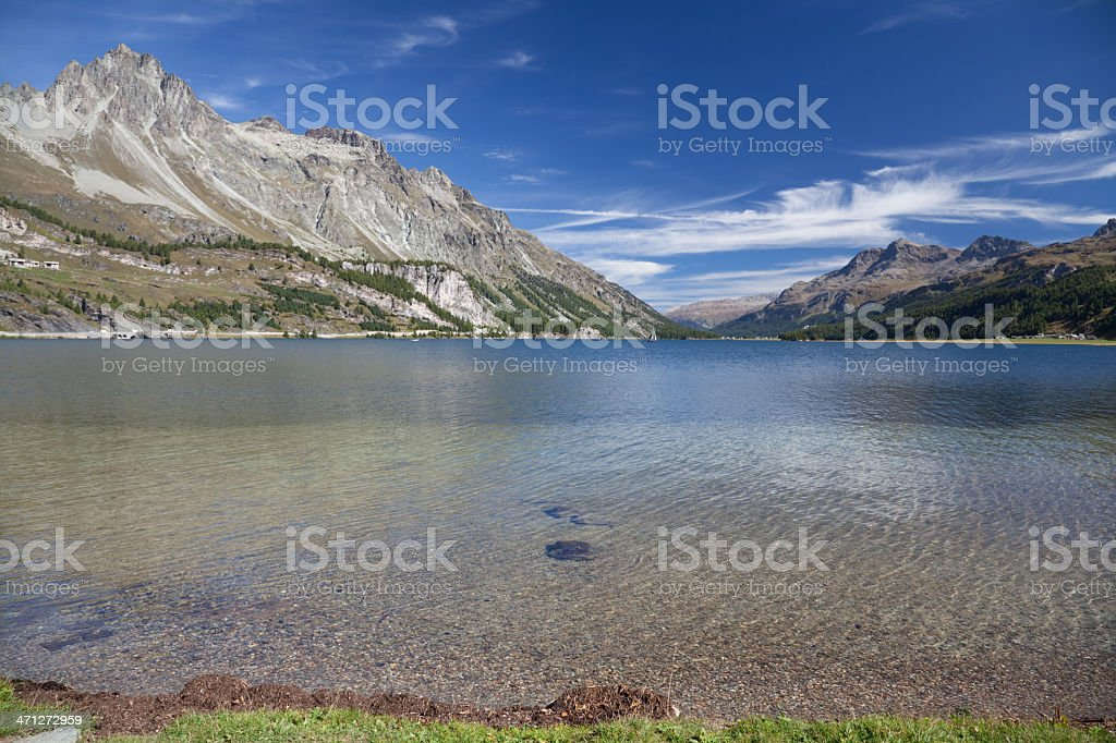 Piz Lagrev and Crystal clear Lake Sils, Engandine, Grisons, Switzerland royalty-free stock photo