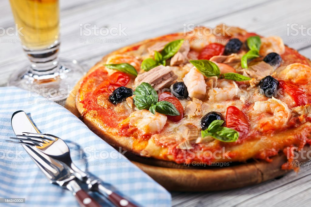 Pizza and glass of beer royalty-free stock photo