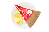 pizza and potato crisps from a paper
