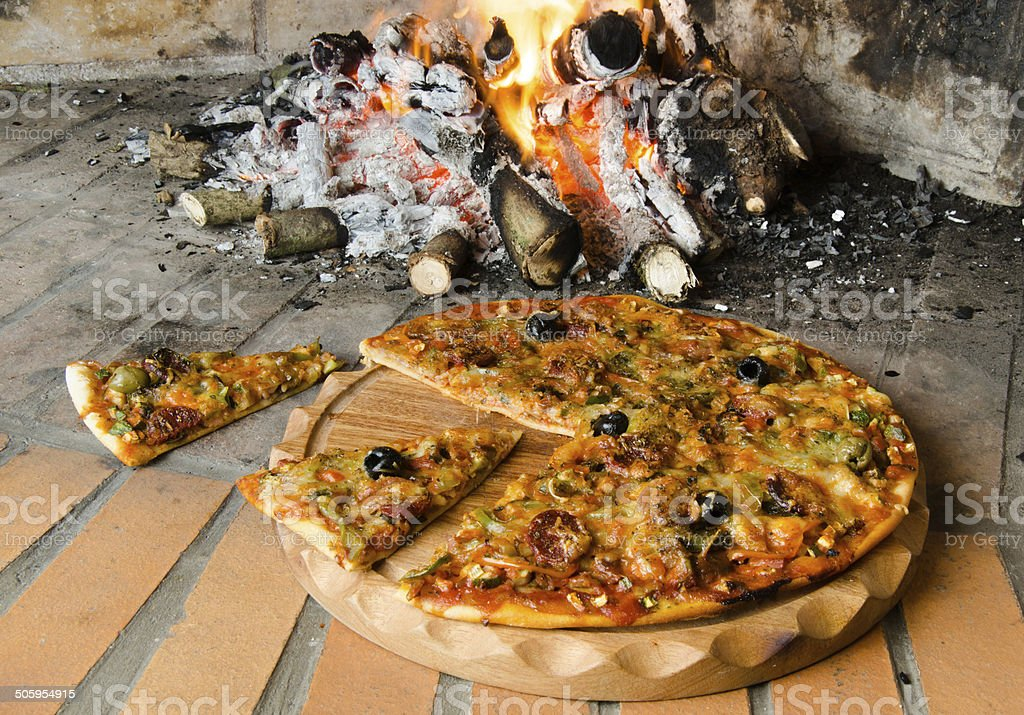 Pizza and slices of pizza stock photo