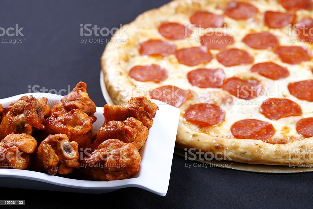 pizza and wings combo royalty-free stock photo