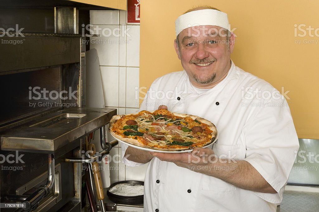 Pizza baker stock photo