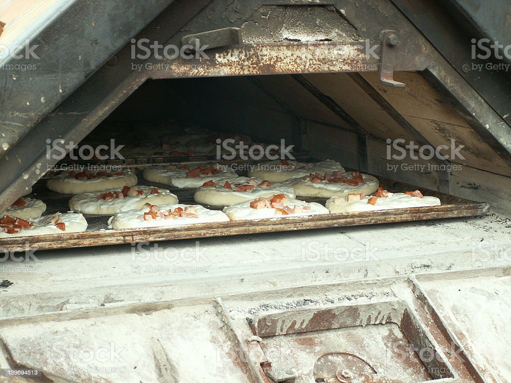 Pizza baking in a tradicional furnace royalty-free stock photo