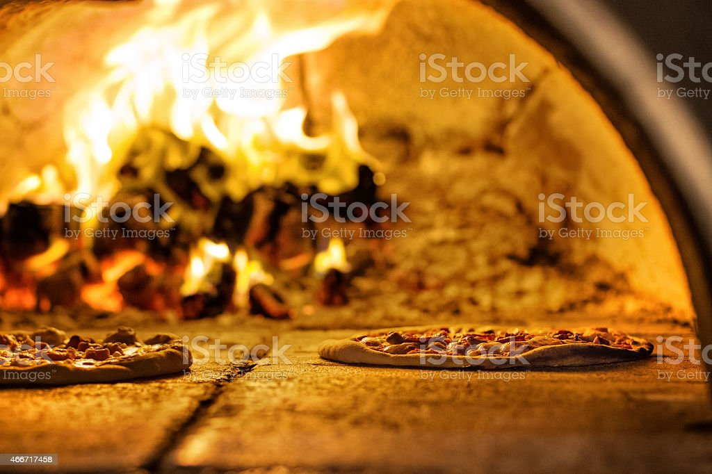 Pizza Baking In Traditional Oven stock photo