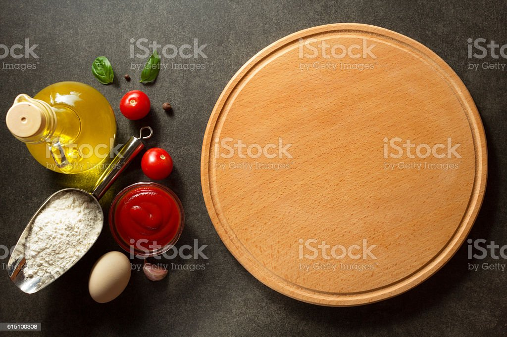 pizza board at table stock photo