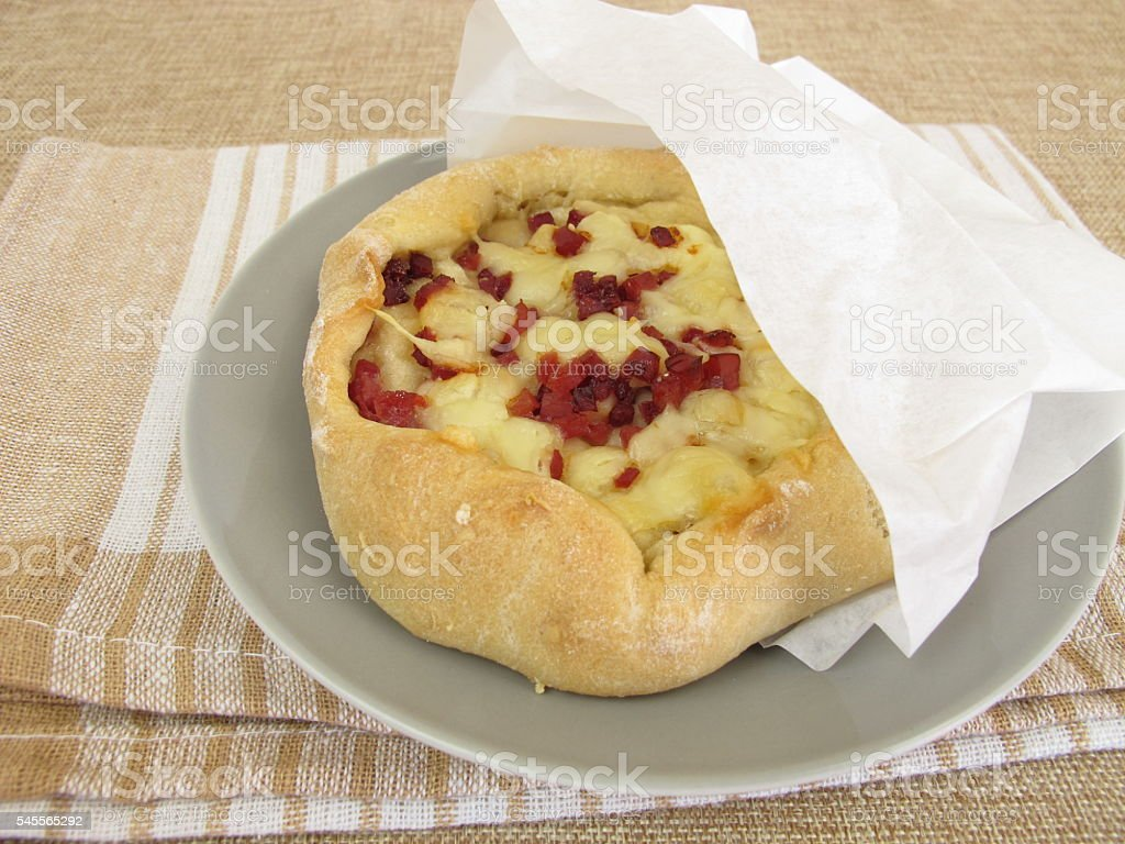 Pizza bread streetfood in greaseproof paper bag stock photo