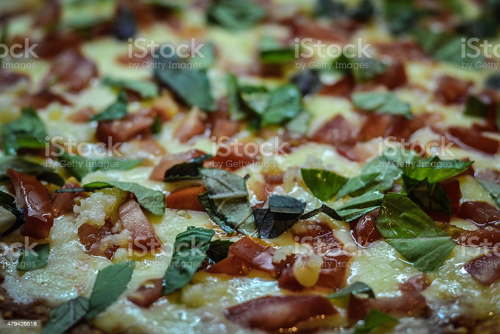 Pizza caprese - mozzarella, basil, tomatoes close up photo stock photo