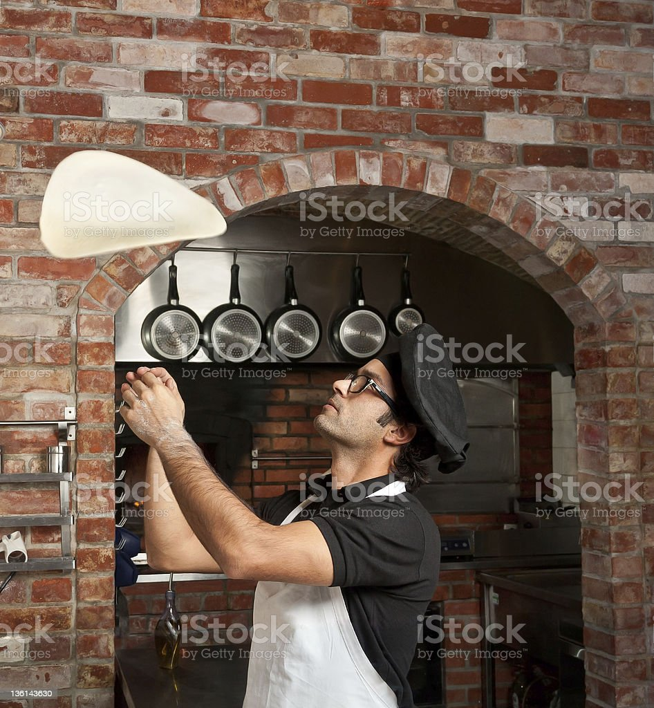 Pizza Chef playing with Dough stock photo