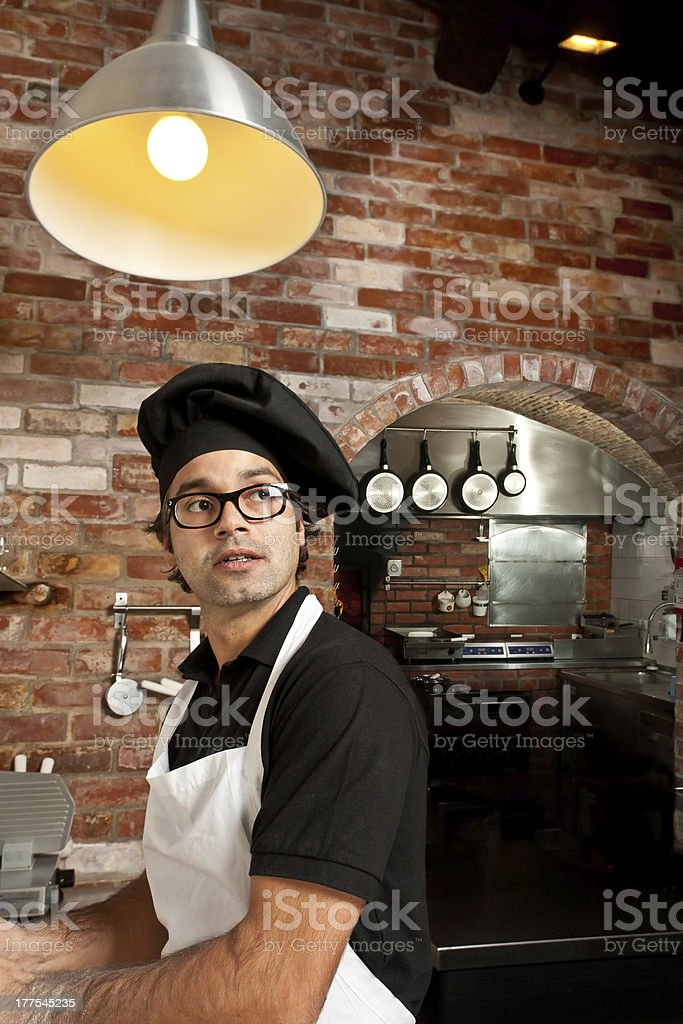 Pizza Chef standing in the kitchen working stock photo