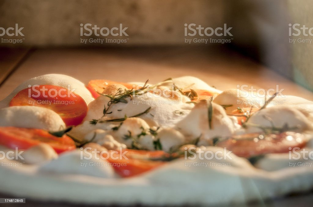 Pizza Cooking In An Oven royalty-free stock photo