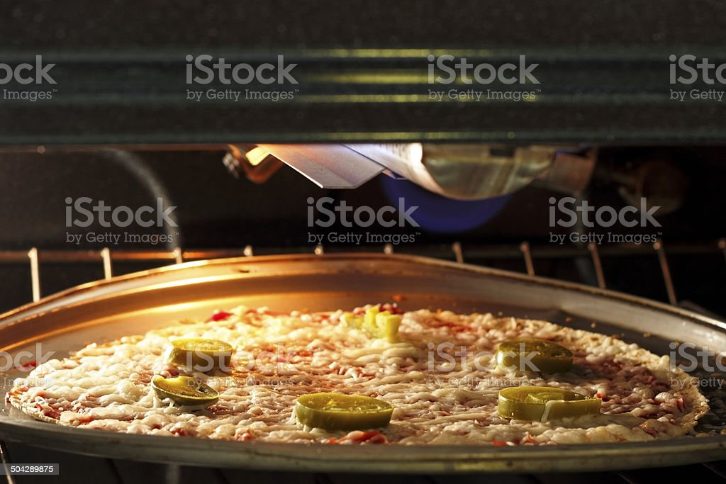 Pizza Cooking in the Oven stock photo