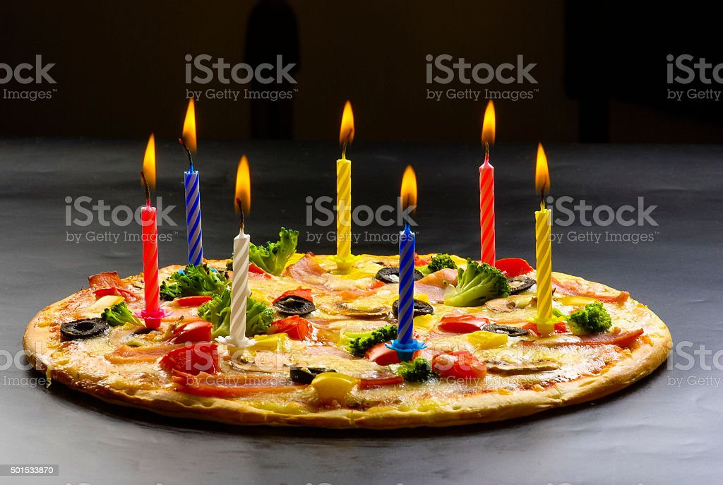 Pizza creative with candles stock photo