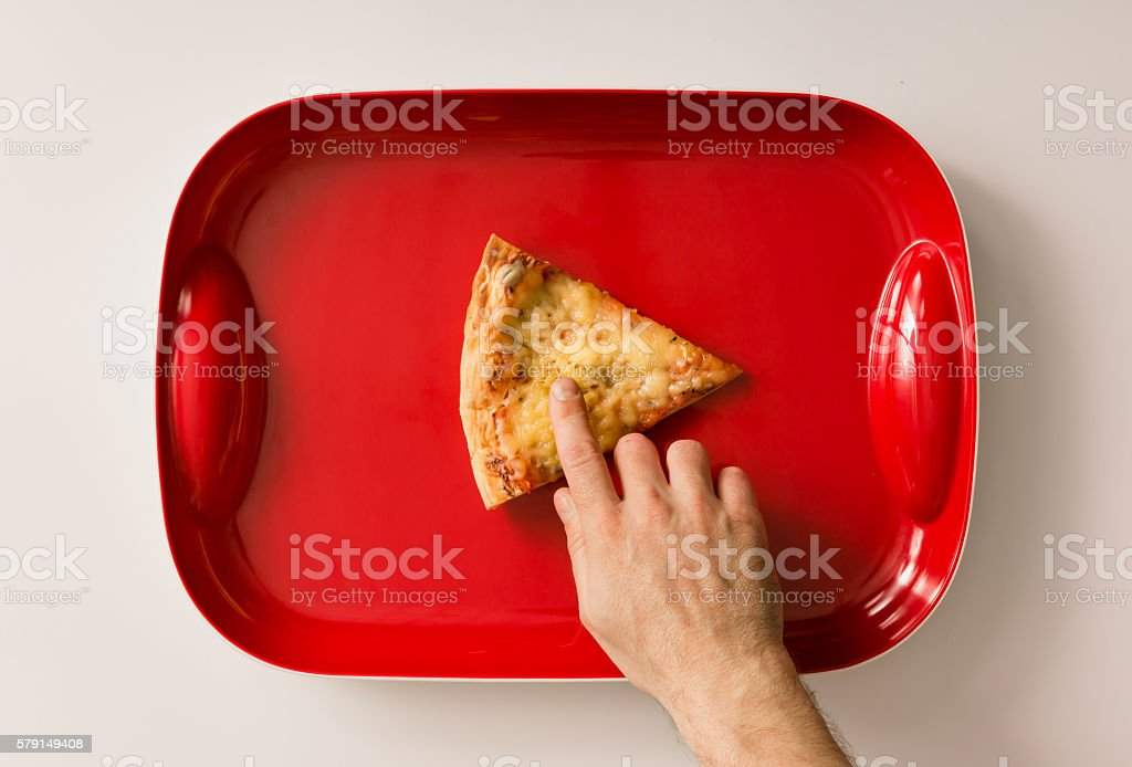 Pizza cut on red tray stock photo