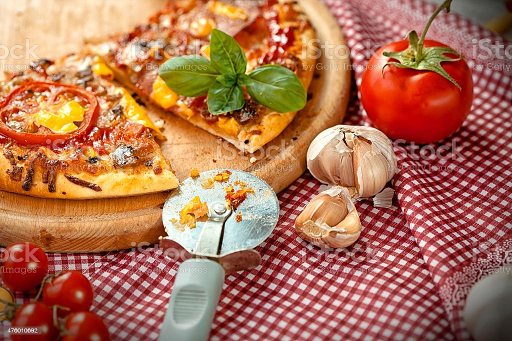 pizza cutter and pizza stock photo