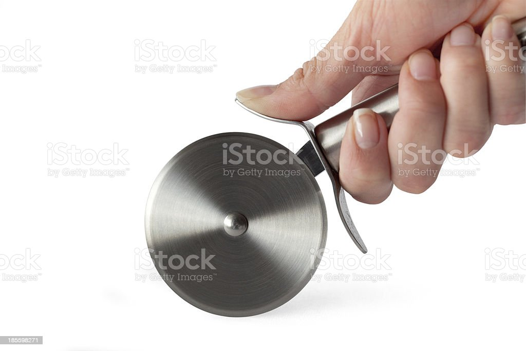Pizza Cutter in Woman's Hand (With Clipping Path) stock photo