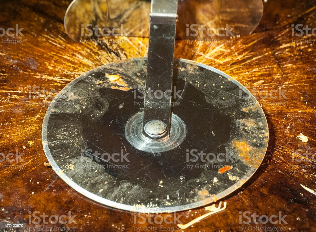 Pizza Cutter On A Pizza Stone stock photo