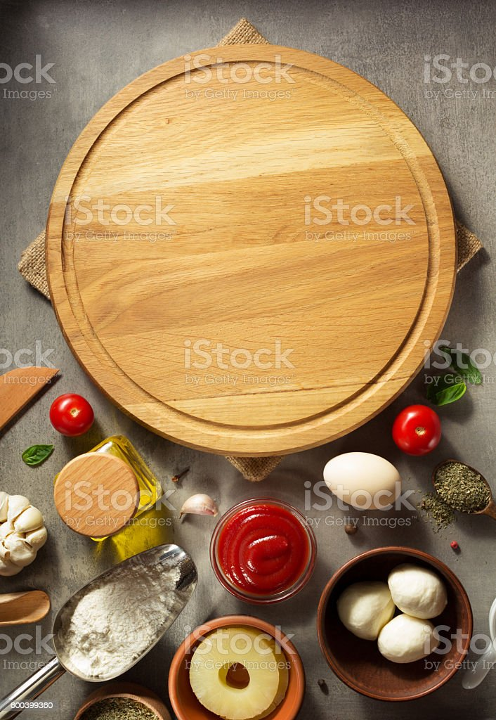 pizza cutting board at table stock photo