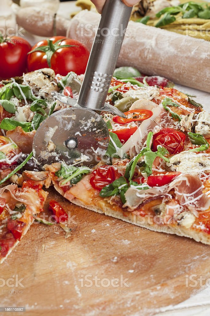 pizza cutting royalty-free stock photo