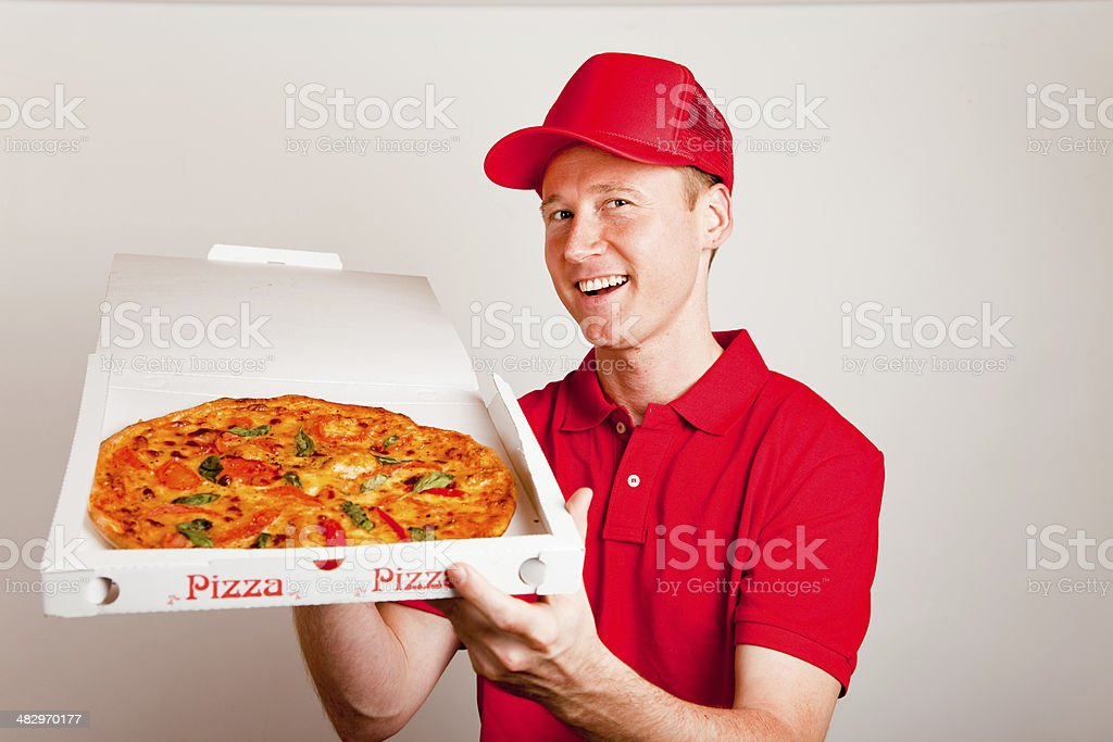 pizza delivery boy stock photo