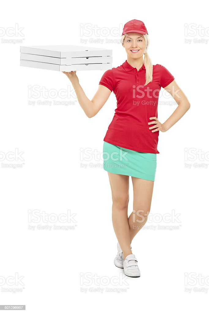 Pizza delivery girl holding boxes stock photo