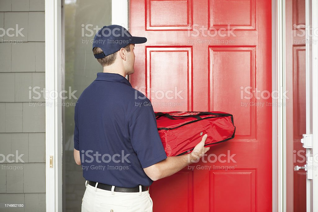 Pizza Delivery Man Delivering Take-out Package to Customer's Door Hz stock photo