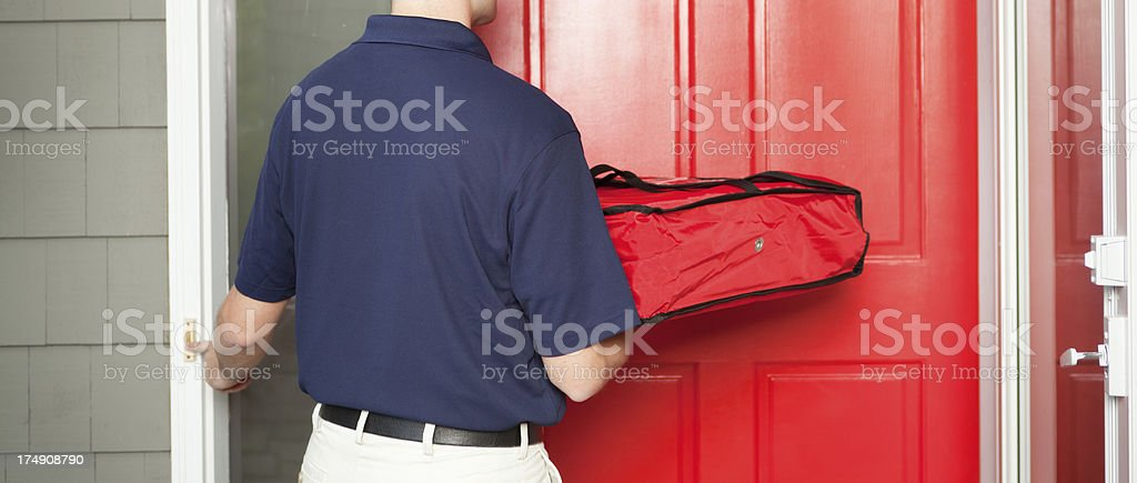 Pizza Delivery Man Delivering Take-out Package to Customer's Home Hz royalty-free stock photo