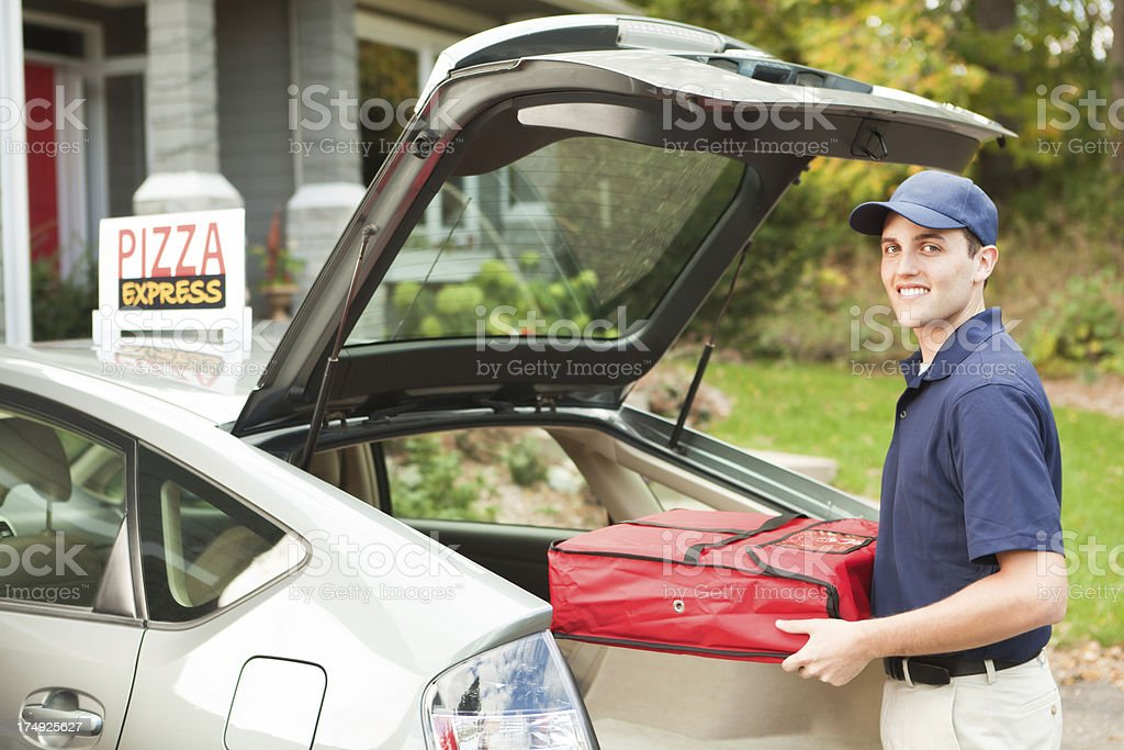 Pizza Delivery Man with Take-out Package Arriving at Customer Hz stock photo