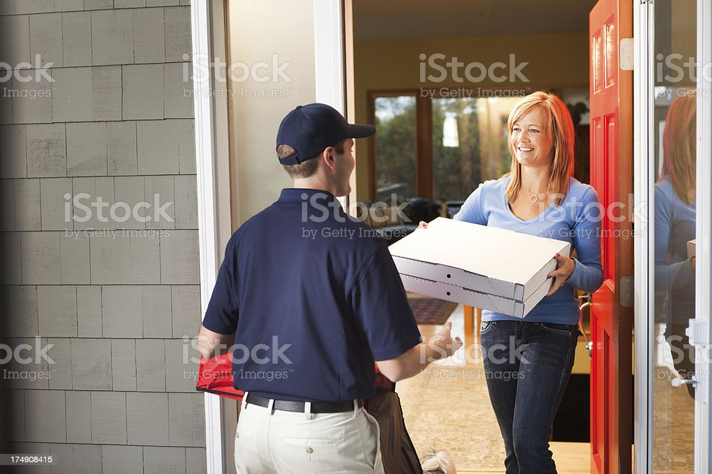 Pizza Delivery Man with Take-out Package at Customer's Door Hz stock photo
