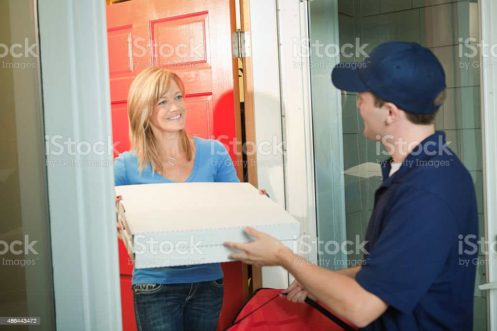 Pizza Delivery Man with Take-out Package at Customer's Door stock photo