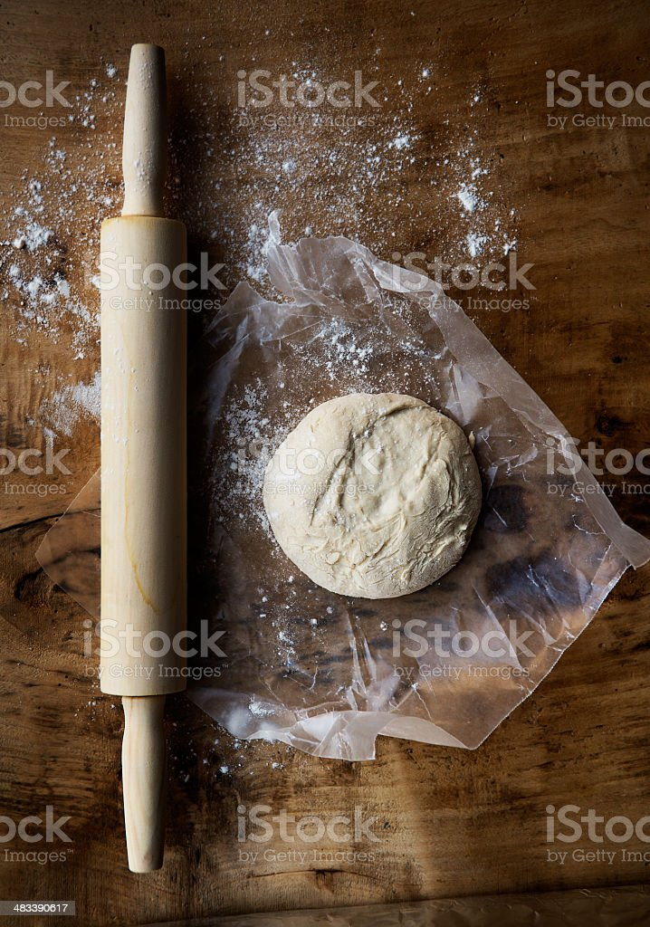 Pizza dough and a rolling pin stock photo