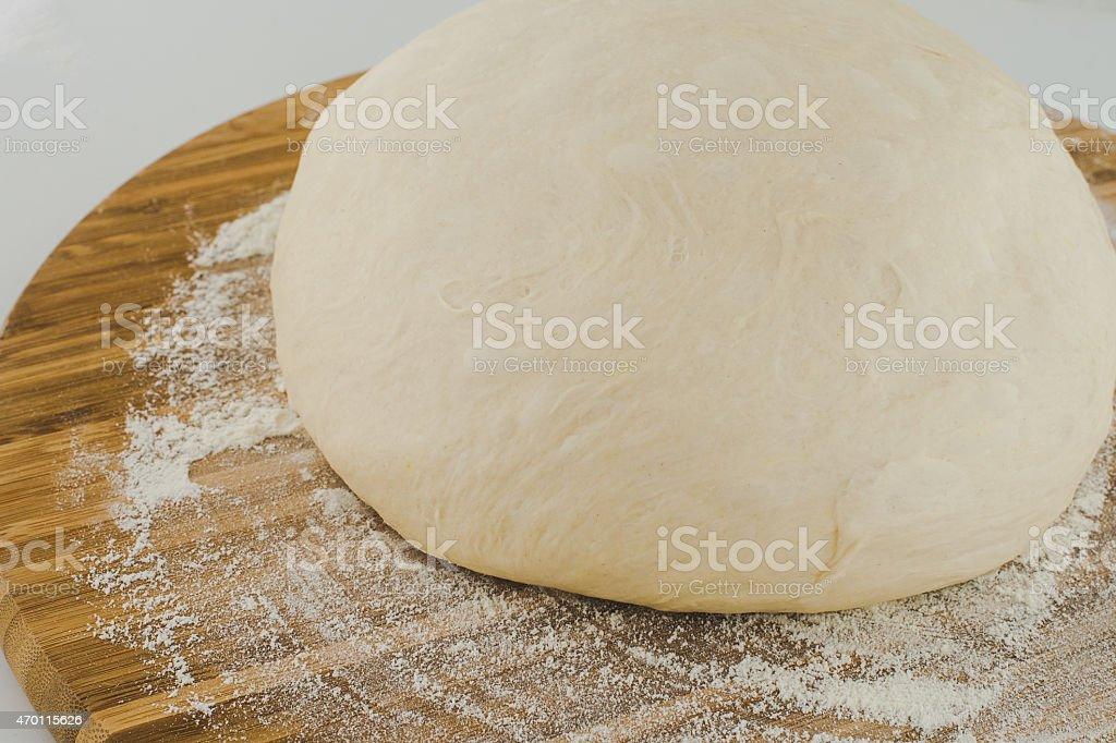 Pizza Dough Ball on wood board stock photo