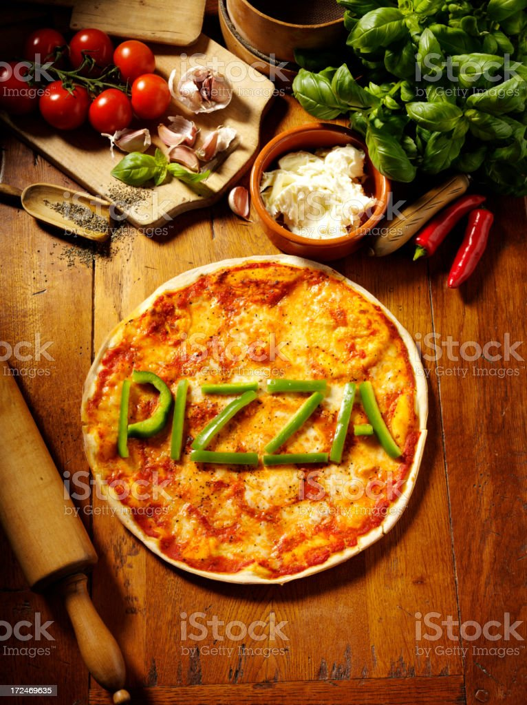 Pizza in Green Peppers with Fresh Herbs and Vegetables royalty-free stock photo