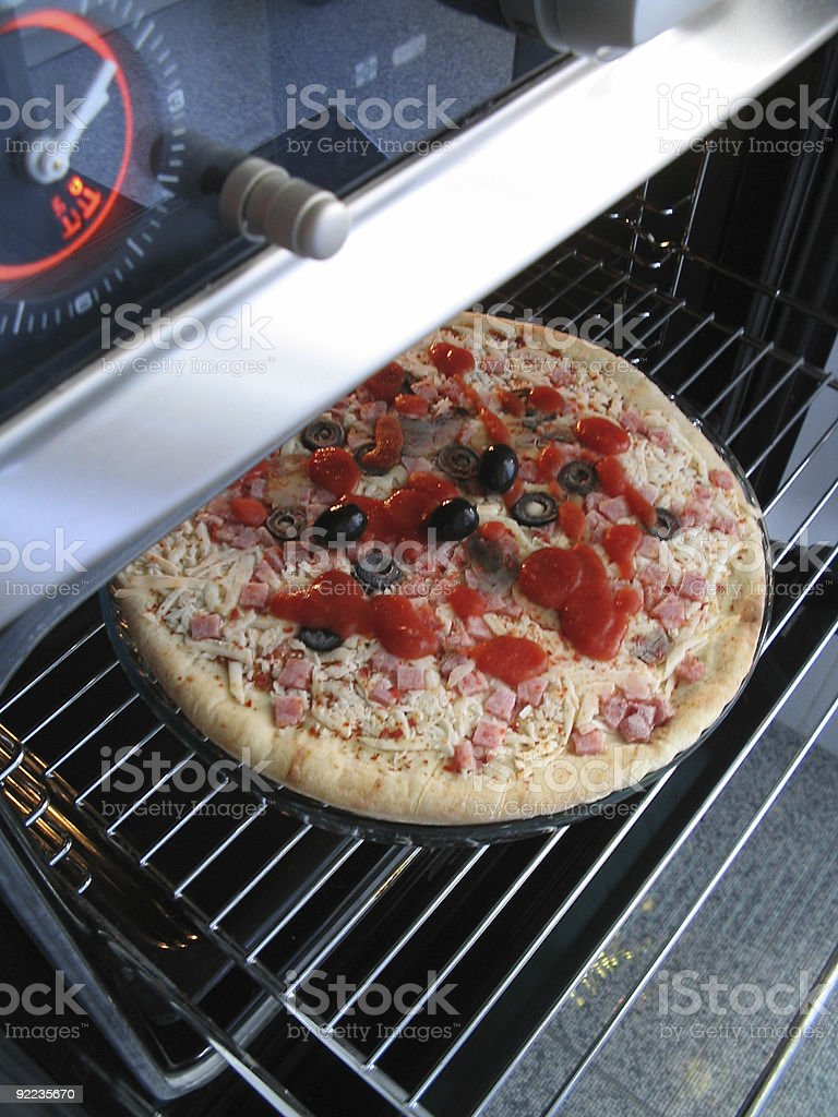 Pizza in oven stock photo