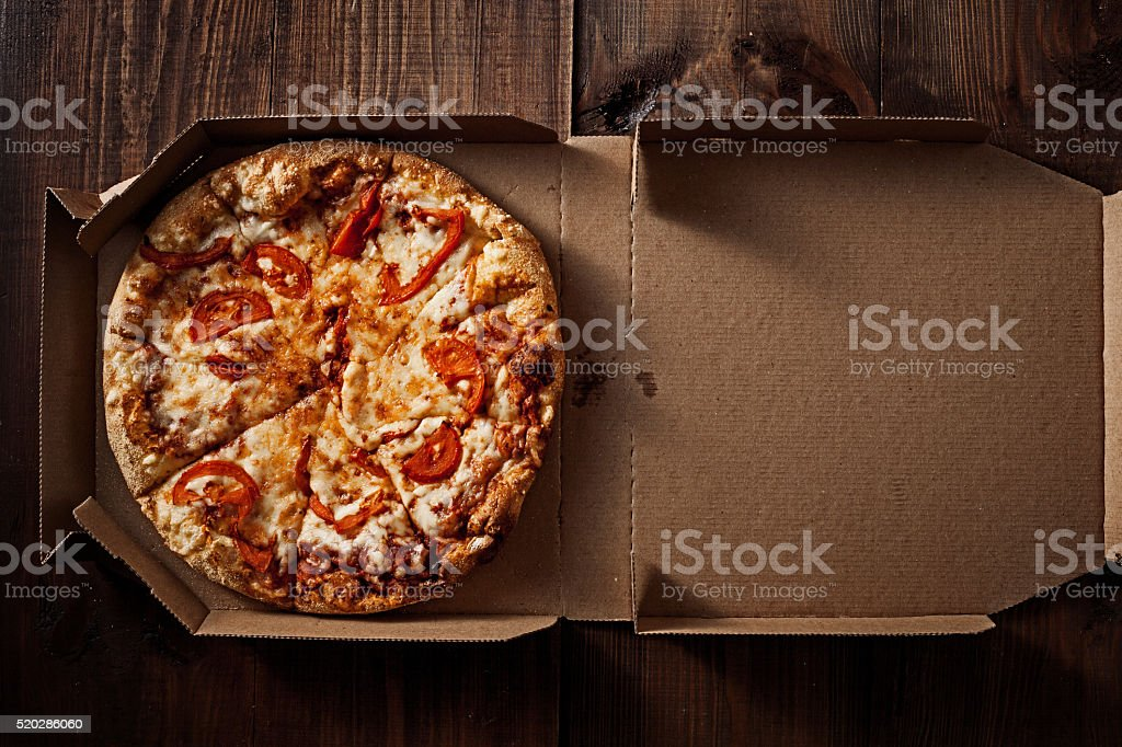 pizza in the in delivery box on the wood stock photo
