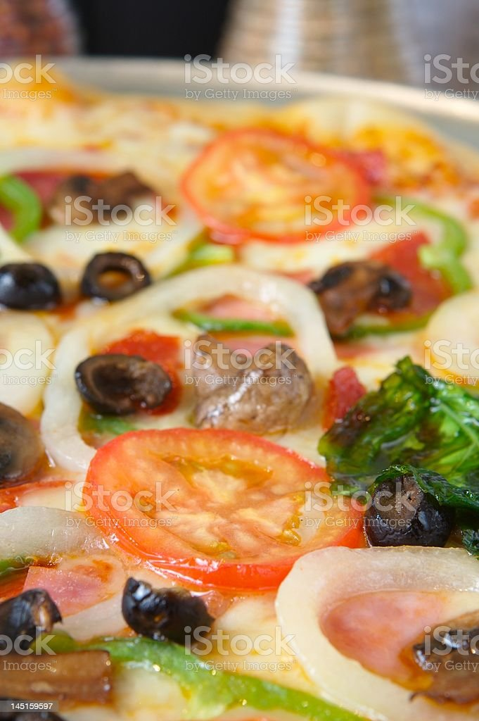 Pizza loaded royalty-free stock photo