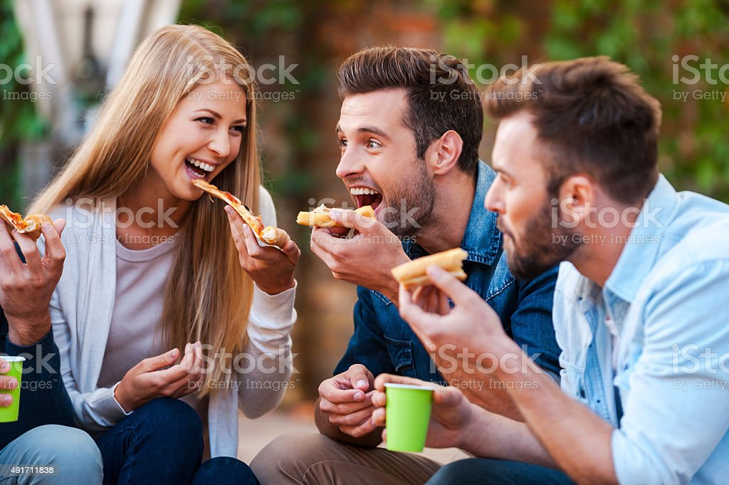 Pizza lovers. stock photo