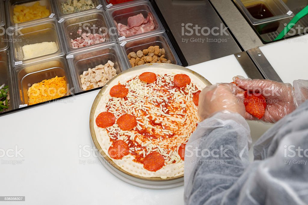 Pizza maker at a kitchen stock photo