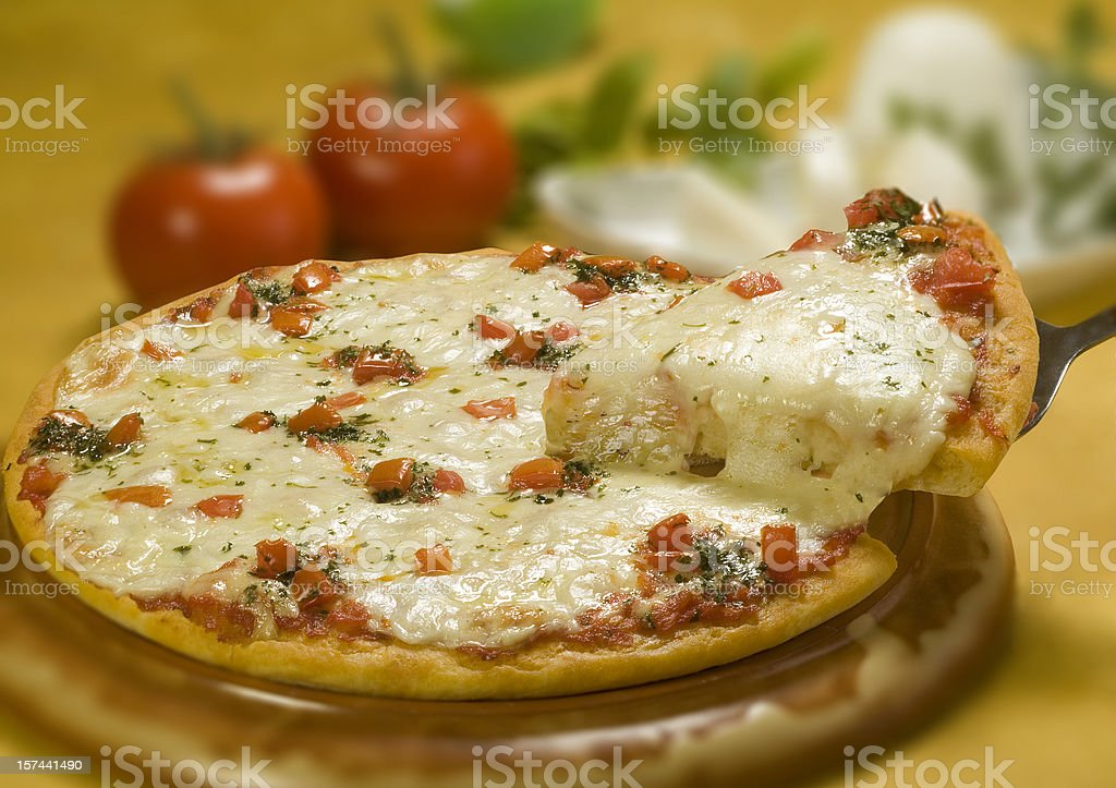 Pizza Margherita and slice royalty-free stock photo