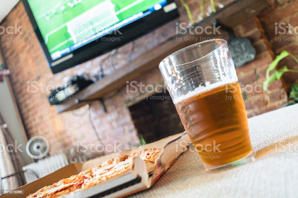 pizza margherita in the box on the living room stock photo