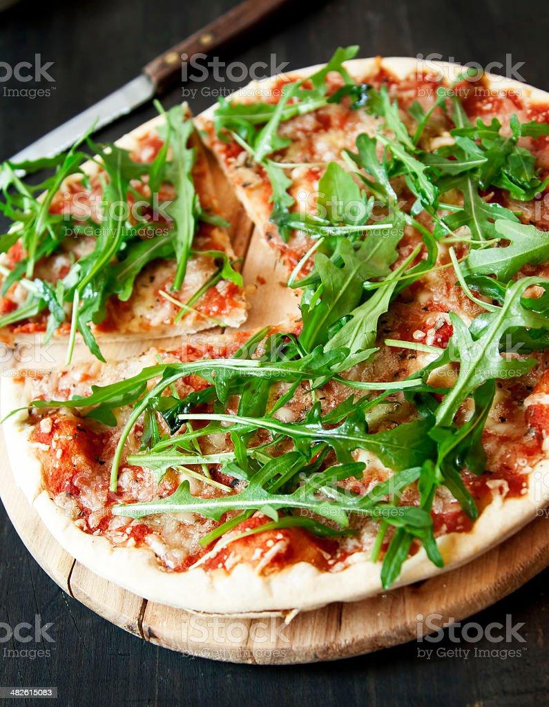 Pizza Margherita with Fresh Arugula Leaves royalty-free stock photo