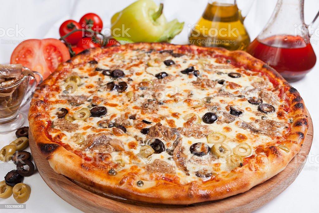Pizza Marinara with tuna stock photo