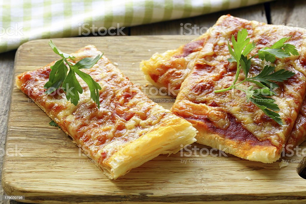 pizza of puff pastry with tomato sauce and parsley royalty-free stock photo