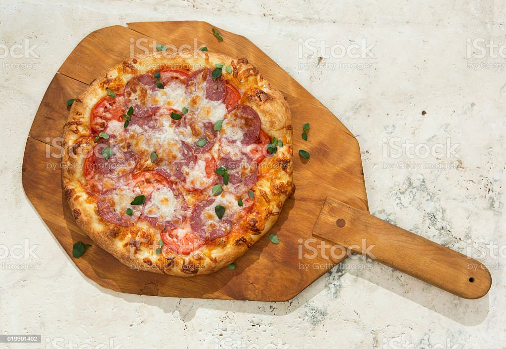 Pizza on a Cutting Board stock photo